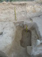 Chronicle of the Archaeological Excavations in Romania, 2009 Campaign. Report no. 51, Pantelimon, Cetate<br /><a href='http://foto.cimec.ro/cronica/2009/sistematice/051/Mormant-cenotaf-care-taie-podeaua-edificiului-din-secIV.JPG' target=_blank>Display the same picture in a new window</a>